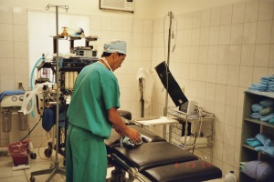Paul, the anesthesiologist, cleaning the OR table