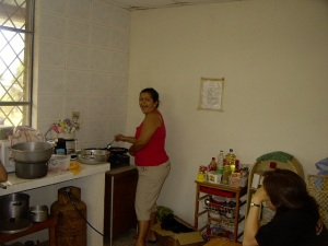 I surprised Damarys with this picture.  Loida is sitting at the table.  Lunch was being prepared.