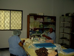 Maria Luisa and Angelita working in the sterilization room.