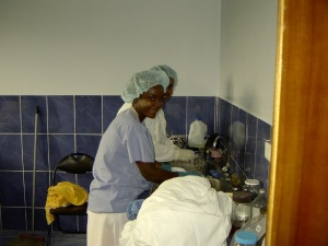 Maria and Angelita washing drapes and instruments.  Maria stood and washed drapes and instruments all week for us.