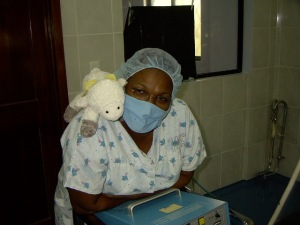 Maria Luisa was posing with the little lamb that each child receives as a gift from the clinic.