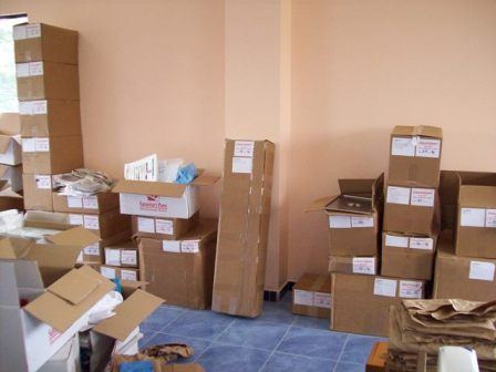 Lots of boxes full of supplies that need sorted and distributed