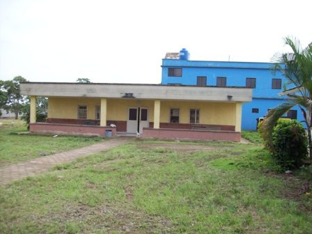 The original clinic building with the new clinic behind it