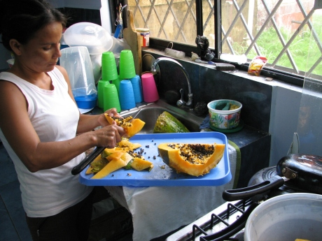 Carmen preparing the papaya