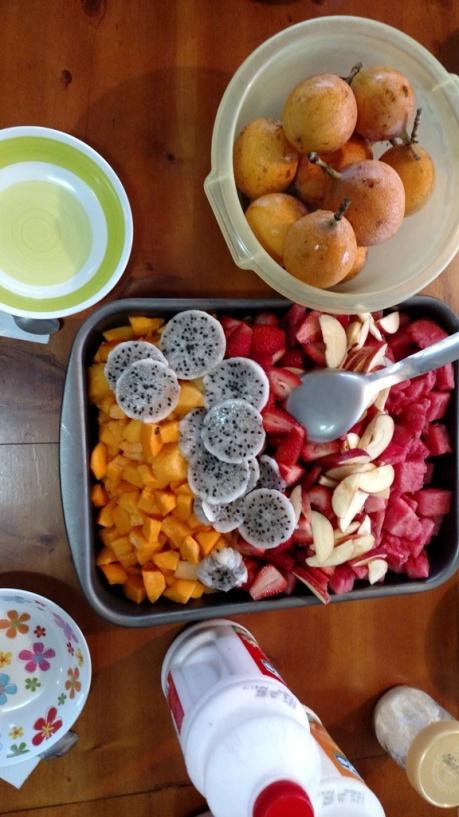 L-R: paypaya, pitajaya, strawberries, apple, watermelon. Granadilla in the bowl
